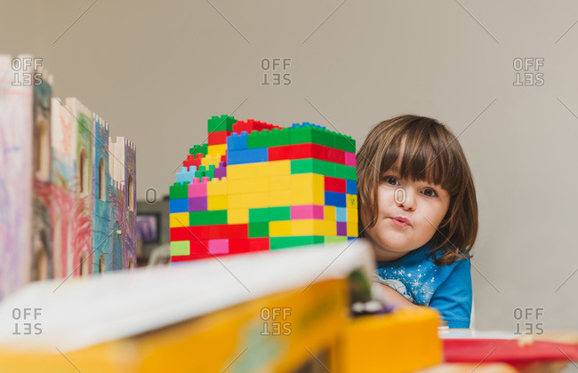Girl by building block structure