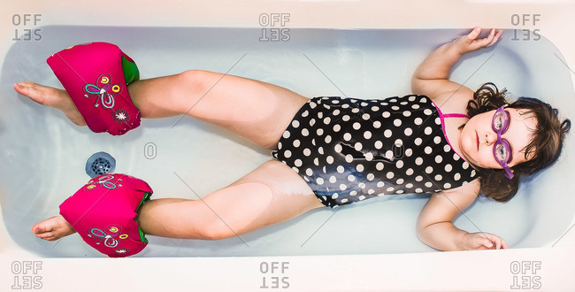 Girl in bathing suit in tub