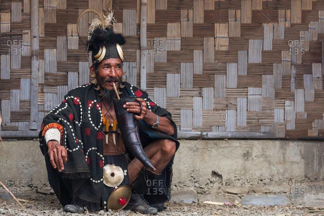 Nagaland, India - December 2, 2015: Indian man dressed for tribal festival