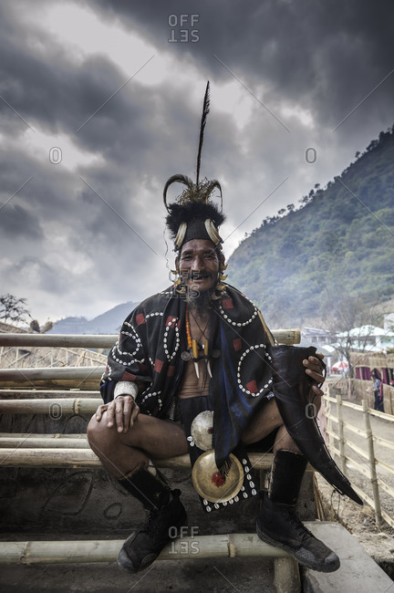 Nagaland, India - December 2, 2015: Smiling Indian man in festival costume