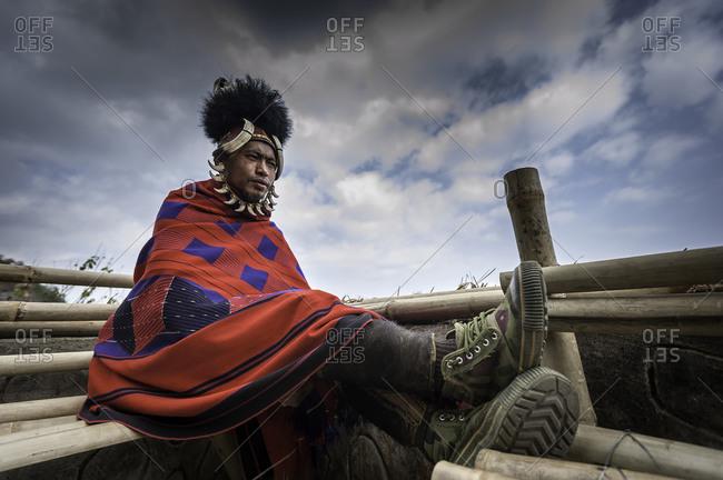 Nagaland, India - December 9, 2015: Indian man resting at tribal festival