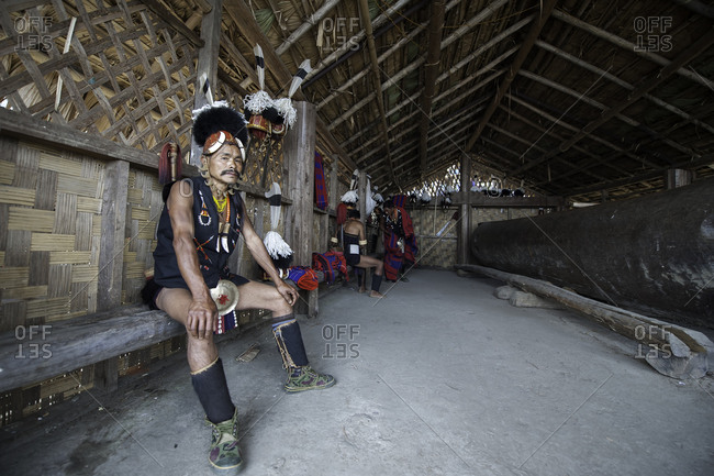 Nagaland, India - December 10, 2015: Indian man in festival costume relaxing