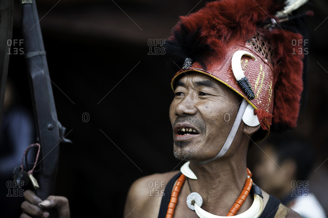 Nagaland, India - December 10, 2015: Indian man with rifle at tribal festival