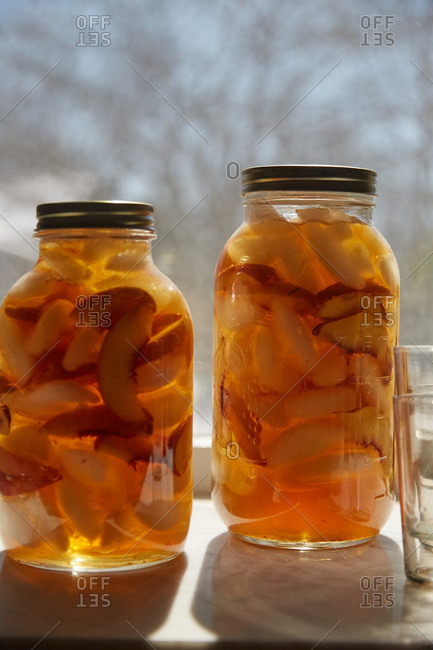 Peaches in liquid in a jar