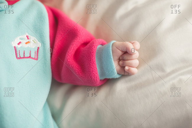 Infant's hand in pajamas