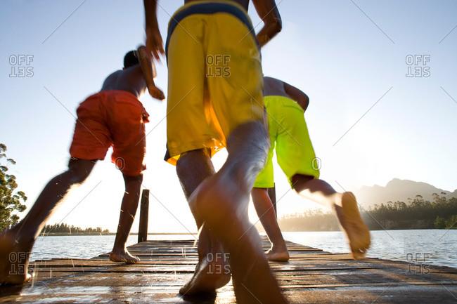 Boys running on dock