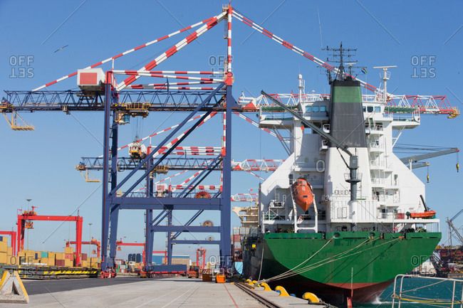 Cranes and container ship at commercial dock