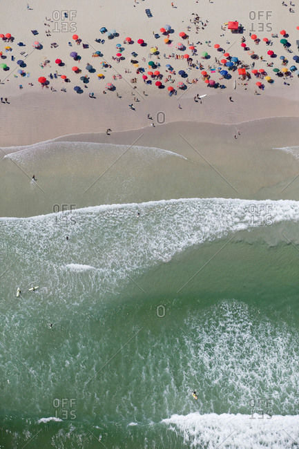 Aerial view of tourists on sunny beach
