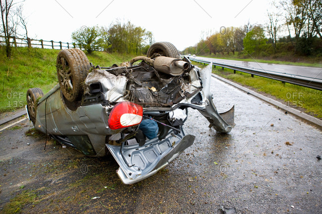 Upside down crashed car on motorway
