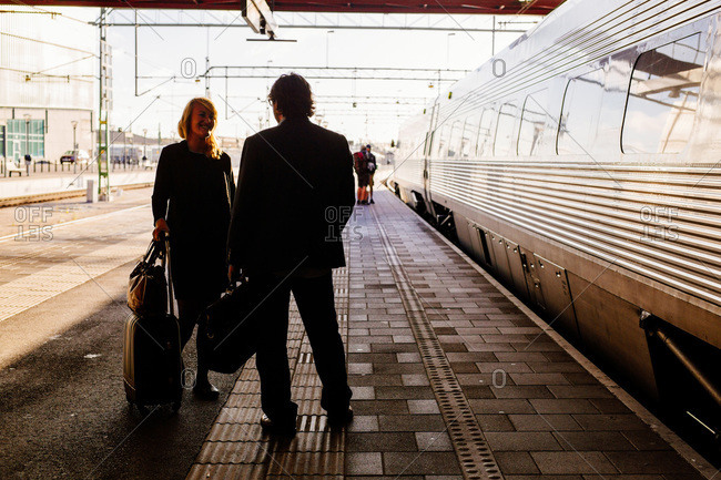 Business people chatting at railroad station