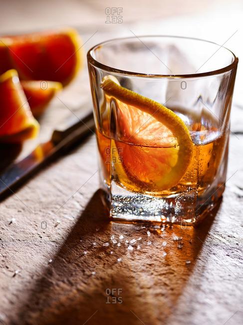 Liquor in a glass with a fresh orange slice