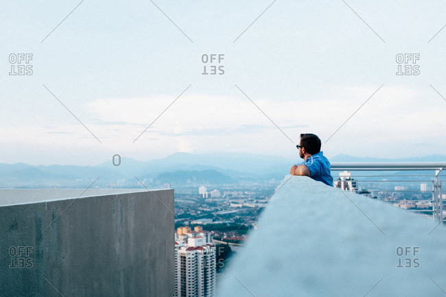 Man looking at view from roof deck