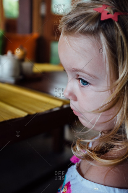 Profile of girl sitting quietly
