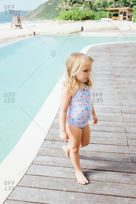 Girl on the deck of a beachfront pool