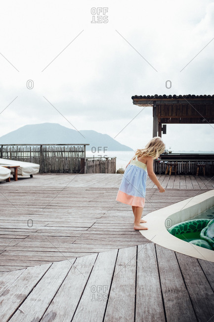 Girl looking at a pool float in a pool