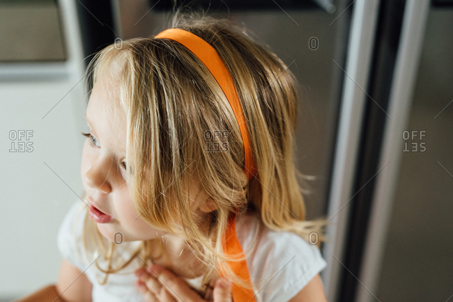 Girl with an orange ribbon in her hair