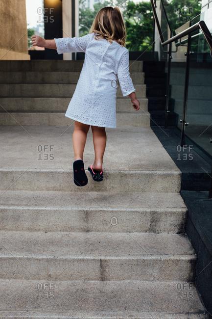 Girl climbing concrete steps