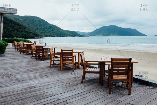 cafe tables on a beachfront deck