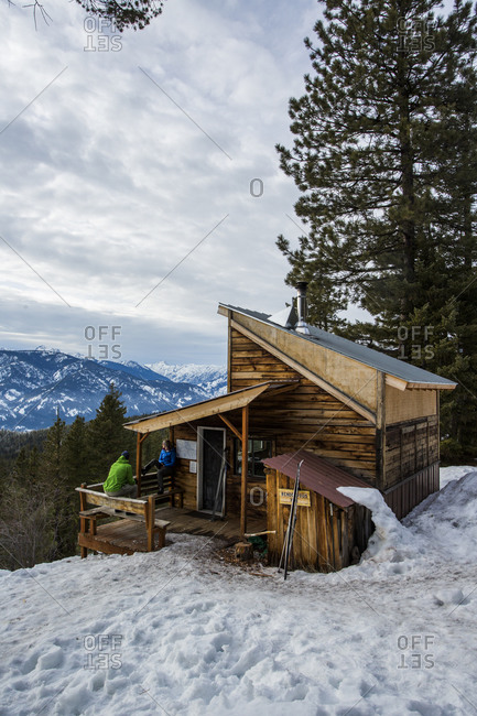 Washington, United States - January 31, 2015: Cross country skiers on the porch of the Rendezvous Cabin on a mountain ridge