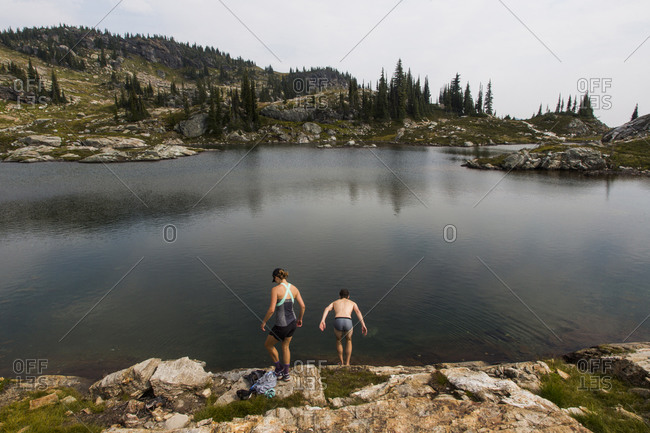 Young people swimming in an alpine lake