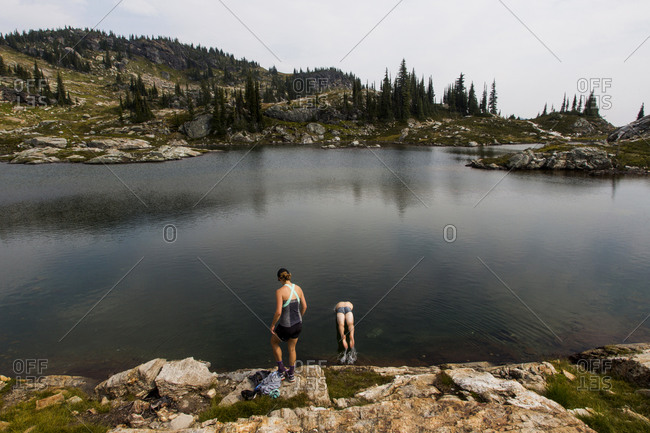 Young people taking a swim in an alpine lake