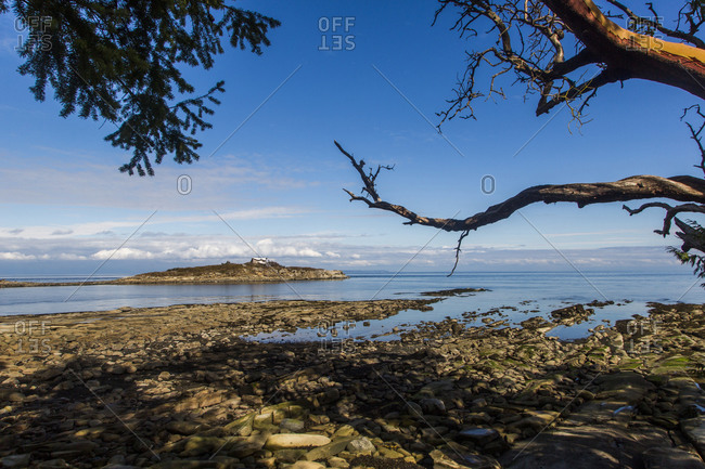 Blue skies and calm waters at a rocky beach