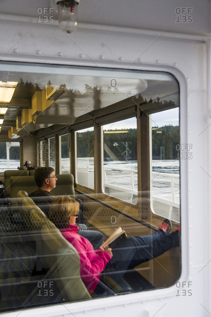 Galiano Island, Canada - September 17, 2015: Couple sitting together on a ferry boat