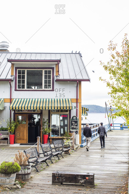 Pender Island, Canada - September 18, 2015: Two people walking by Cafe at Bay Hope