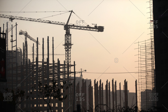 A construction site with cranes over Tehran