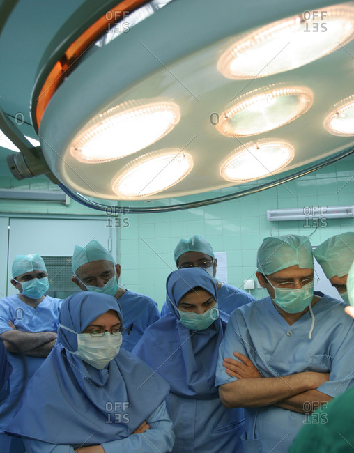 Tehran, Iran - December 30, 2015: Medical workers intently watching a surgery