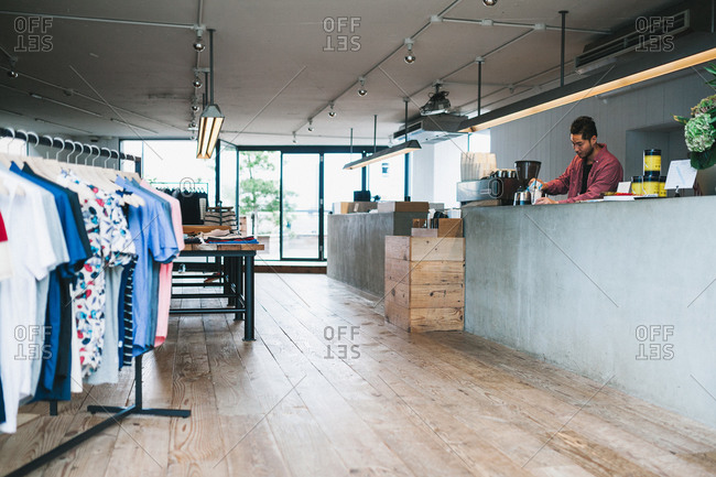 Tokyo, Japan - June 21, 2015: Barista making an iced coffee at Saturdays NYC caf� and retail store