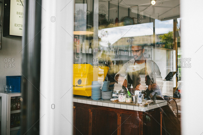Auckland, New Zealand - March 21, 2015: Barista working at Dear Jervois Caf�