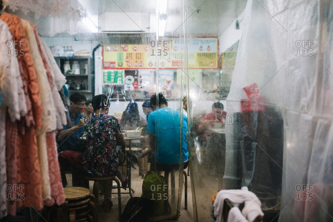 Hong Kong - June 10, 2015: Patrons eating at a restaurant in Wanchai