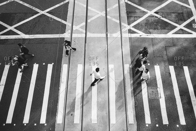 Pedestrians crossing a city street