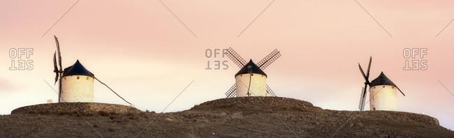 Three windmills at dawn