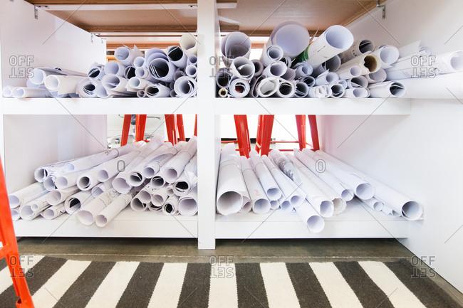 Rolls of paper on shelves