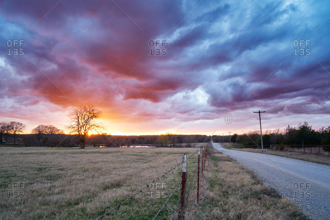 Dramatic sunset over a rural road