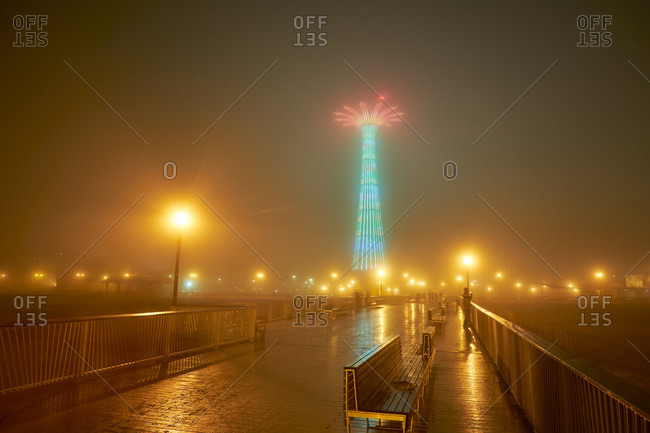 Parachute jump and pier at night in Coney Island