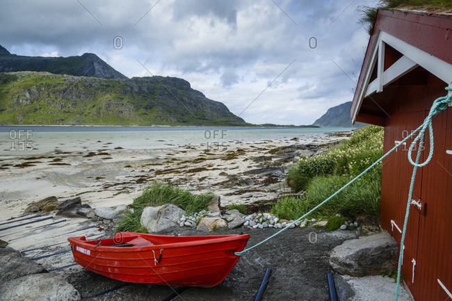 Boat and a fishing cabin in the northern part of Lofoten Islands, Norway