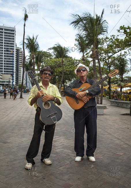 Fortaleza, Brazil - December 28, 2012: Guitar players on the promenade in Praia do Meireles