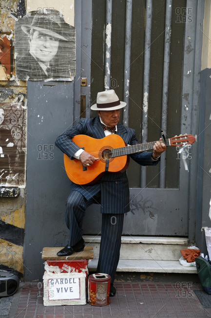 Buenos Aires, Argentina - January 26, 20120: Portrait of a guitar player performing at the Sunday Flea Market in San Telmo
