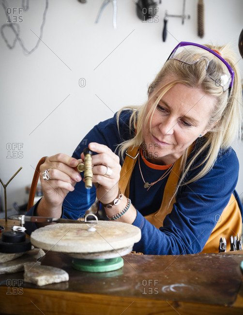 Lofoten Islands, Norway - July 17, 2013: Catrine Linder, a silversmith at her shop in Henningsvaer village,  Lofoten Islands, Norway