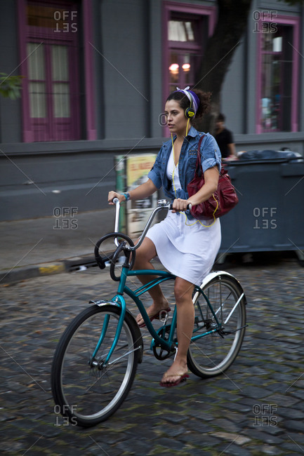 Buenos Aires, Argentina - April 1, 2012: Woman riding bicycle at the trendy neighborhood of Palermo Soho