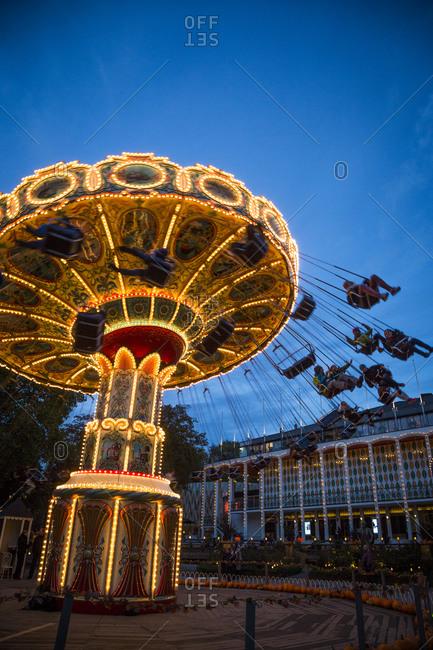 Copenhagen, Denmark - October 12, 2012: Swings at nighttime at the Tivoli Gardens