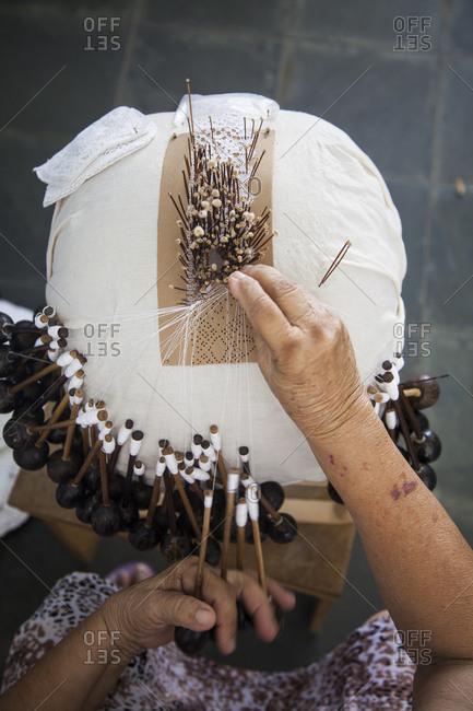 Woman making lace in a traditional way at Centro de Turismo do Ceara from above