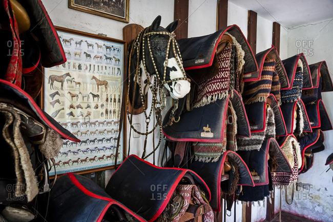 Cordoba Province, Argentina - February 12, 2012: Saddles room at Estancia Los Potreros, Cordoba Province, Argentina