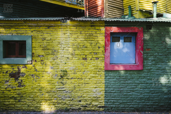 Colorful painted brick exterior wall