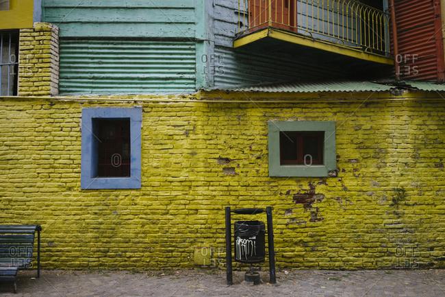 Colorful brick exterior wall and trash can