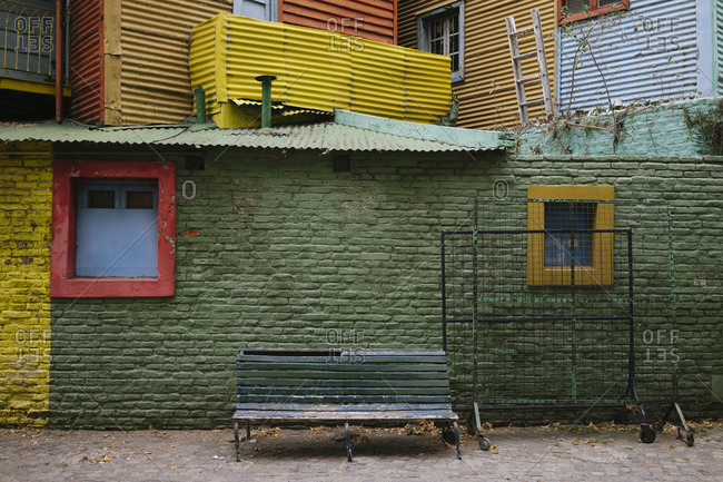Colorful brick exterior wall and bench