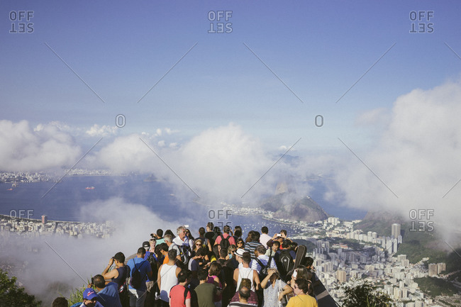 Rio de Janeiro, Brazil - April 17, 2015: Tourists standing in line on Corcovado Mountain to see Christ the Redeemer